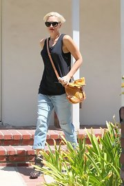 Gwen Stefani was dressed down in a tank and jeans, accessorized with a yellow satchel, while visiting a friend in LA.