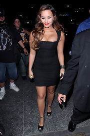 Demi Lovato complemented her dress with black platform peep-toes.
