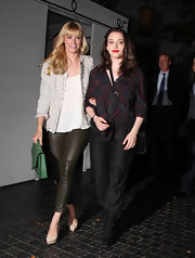 Kat Dennings looked sporty in a patterned button-down tied at the waist while leaving Chateau Marmont.