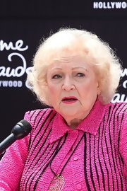 Betty White wore her hair in a curly bob during the unveiling of her wax figure at Madame Tussauds.