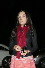 Famke Janssen tied a pretty dotted scarf around her neck while out with friends in NYC.