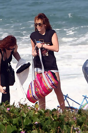 Miley Cyrus accessorized with a tribal-print duffle bag.