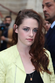 Kristen Stewart rocked messy-glam side-swept waves at the Balenciaga Spring 2013 show.