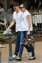 Ashley Madekwe kept a low profile in a Brian Lichtenberg Feline tee while out at the Grove.