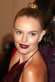 Kate Bosworth went for a sexy, dramatic beauty look with dark red lipstick.
