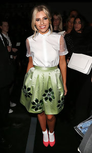 Mollie King's pink pumps provided a pretty contrast to her mint-green skirt.