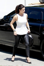 Kim Kardashian stepped out in LA looking chic in a white Zara peplum top and black leather skinnies.
