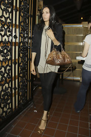 Famke Janssen dined out at Matsuhisa wearing a stylish ensemble and rusty-hued arm candy.