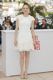 Marion Cotillard wore a beautiful white Alexander McQueen mini dress with 3D flower embroideries for the 66th Annual Cannes Film Festival premiere of 'The Immigrant'.