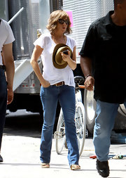 Jennifer Aniston looked super laid-back in an old white tee on the set of 'Squirrels to the Nuts.'