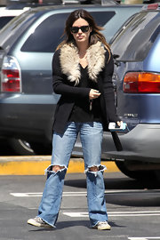 Rachel Bilson contrasted her chic top with rugged, ripped jeans.