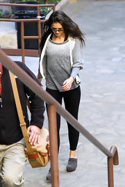 Katie Holmes headed to dance class wearing a pair of gray clogs by Ugg.