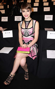 Sami Gayle attended the Herve Leger fashion show carrying a color-blocked box clutch.