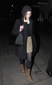 Keira Knightley styled her outfit with a chic black Givenchy Antigona duffle.