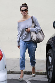 Eva Longoria teamed her top with ripped capri jeans by AG.