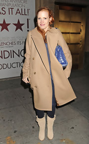 Jessica Chastain teamed nude mid-calf boots with a tan coat for her after-work attire.