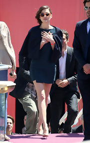 Marion Cotillard arrived for the 'Blood Ties' photocall wearing a navy cropped jacket over a mini dress.