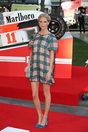 Poppy Delevingne looked breezy on the red carpet in a boldly patterned mini dress during the London premiere of 'Rush.'