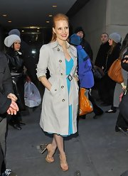 Jessica Chastain posed outside the 'Today Show' studios wearing a classic trenchcoat over a turquoise dress.