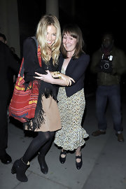 Sienna Miller attended the 'Water for Elephants' premiere after-party carrying a tribal-patterned hobo bag.