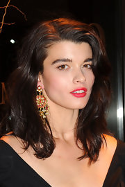 Crystal Renn punctuated her black outfit with a bold red lip.