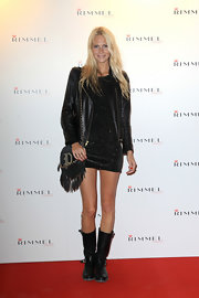 Poppy Delevingne completed her tough-chic red carpet look with a tasseled black shoulder bag.