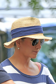 Jennifer Aniston kept the sun out with a straw hat while on the set of 'Squirrels to the Nuts.'