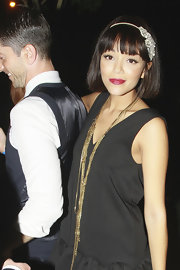 Layered gold chain necklaces added a '20s feel to Ashley Madekwe's look.