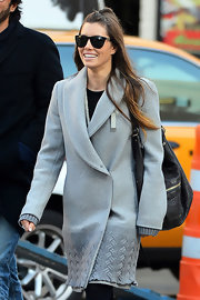 Jessica Biel went on a stroll in NYC carrying a stylish black leather hobo bag.