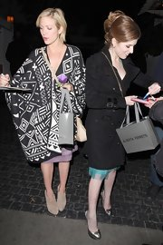 Anna Kendrick was spotted outside Chateau Marmont looking stylish in pewter slingbacks and a black trenchcoat.