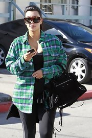 Kim Kardashian banished the rays with a pair of rectangular tortoiseshell sunnies by Celine.