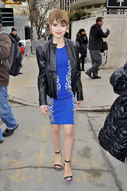 Sami Gayle left the BCBG fashion show wearing a tough-chic black leather jacket over a blue sheath.