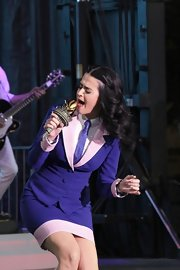 Katy Perry coordinated her skirt suit with a striped purple tie for her performance at a campaign rally for Barack Obama.