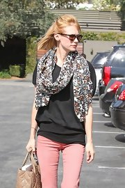 January Jones jazzed up her casual outfit with a butterfly-print scarf for a day out.