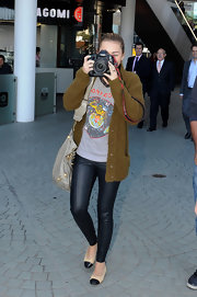 Miley Cyrus finished off her outfit with cute two-tone ballet flats by Chanel.