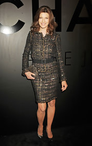 Model Linda Evangelista celebrated the Chanel Bijoux De Diamant's 80th anniversary wearing a classy tweed skirt suit.