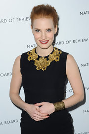 Jessica Chastain was fiercely elegant in black and gold at the National Board of Review Awards. Her gorgeous cuff is by Aurelie Bidermann.