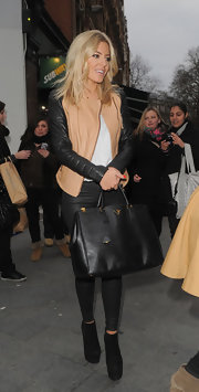 Mollie King topped off her ensemble with a stylish black Prada Saffiano tote.