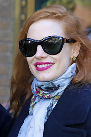 Jessica Chastain headed to her Broadway play wearing oversized cateye sunnies by Tory Burch.