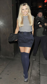 Mollie King covered up her shapely pins in blue thigh-high socks while out clubbing.