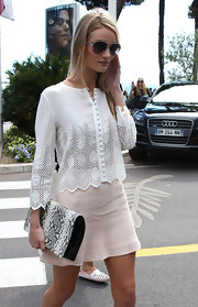 A monochrome snakeskin clutch added some wild appeal to Rosie Huntington-Whiteley's ultra-girly outfit.