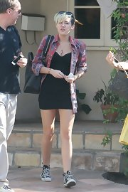 Miley Cyrus toughened up her dress with a plaid button-down by Nasty Gal.
