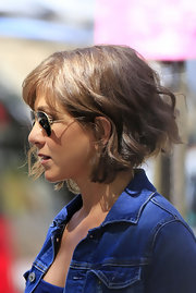 Jennifer Aniston donned this short, curly wig for her new film 'Squirrels to the Nuts.' It was actually a refreshing change from her signature long layered locks!