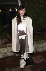 Caroline Sieber arrived for the Sidaction Gala looking glam in an ivory fur coat layered over a printed evening dress.