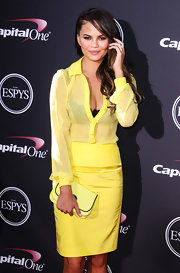 Chrissy Teigen was in the mood for yellow when she attended the ESPY Awards, sporting this Oroton leather clutch, button-down, and pencil skirt combo.