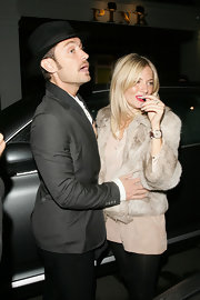Sienna Miller showed off a Cobra & Bellamy leather-band quartz watch while enjoying a date night.