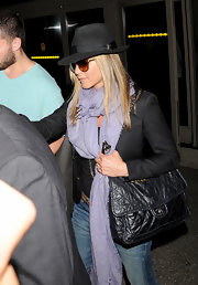 Jennifer Aniston made a luxurious statement at LAX with this quilted black leather bag by Chanel.