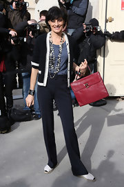 Ines de la Fressange topped her blue tank top with a knit cardigan at the Chanel fashion show.
