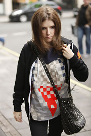 Anna Kendrick amped up the edge factor with a stud and grommet-embellished shoulder bag during her visit to Radio One.