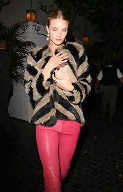 Rosie Huntington-Whiteley teamed a nude suede clutch with a fur coat and leather pants for a night out at Chateau Marmont.